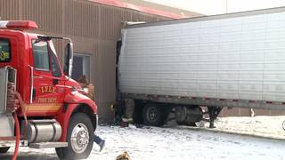 4 people injured in crash that sent semi into school