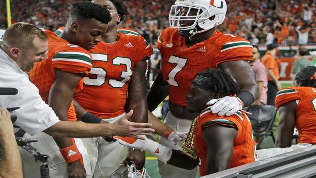 Miami Hurricanes DB Trajan Bandy wears 'turnover chain' on sideline vs Notre Dame