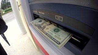 Tips to avoid being a robbery target after you pull money out of the bank