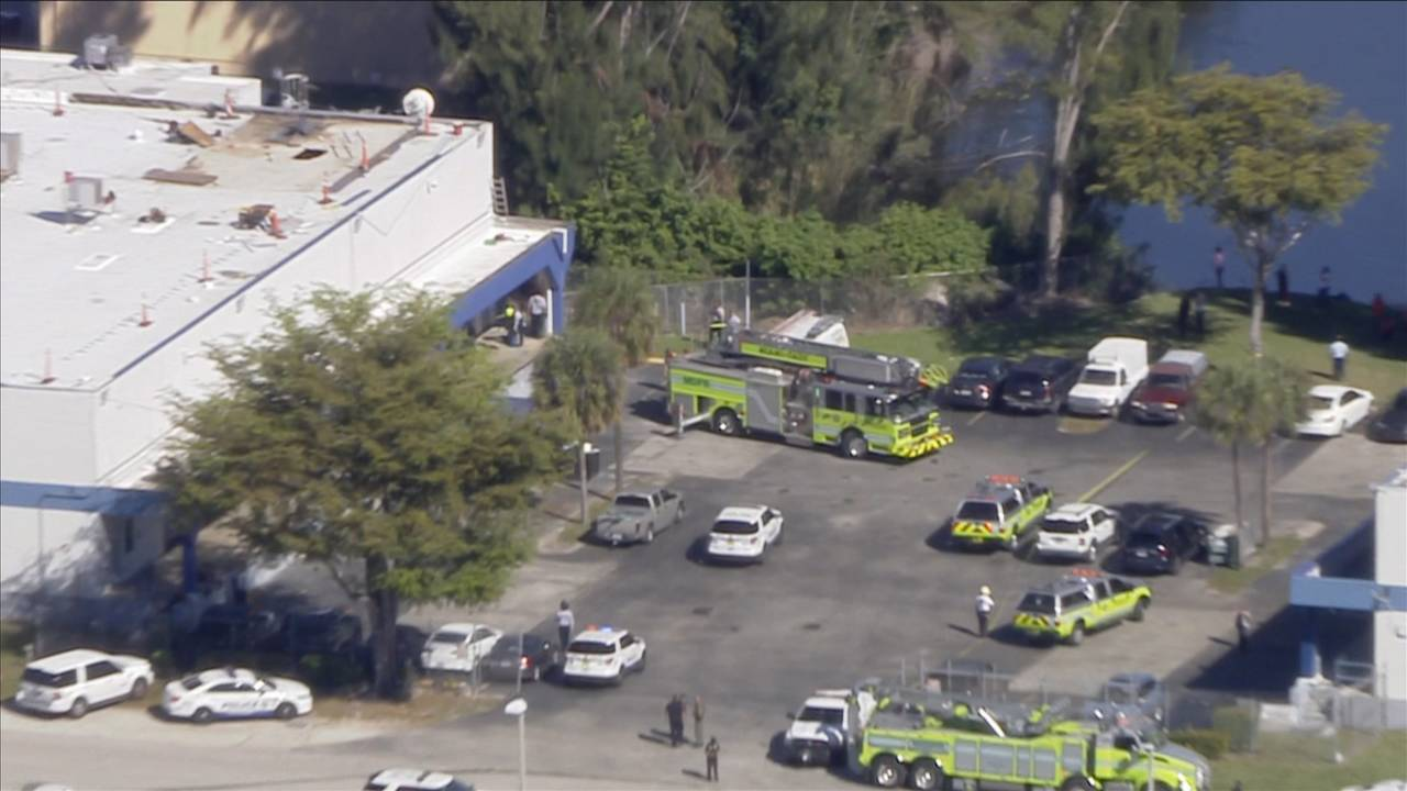 Miami-Dade Fire Rescue trucks at scene of roof collapse