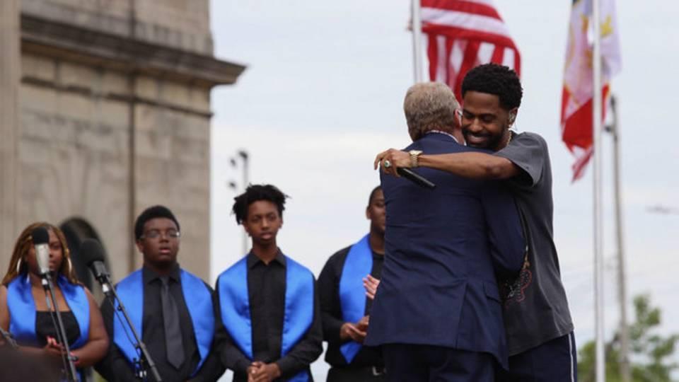 Big Sean and Bill Ford Jr hug_1529425314426.jpg.jpg