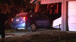 Driver flees after crash sends parked car into building, police say
