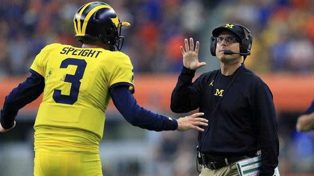 Michigan Quarterback Wilton Speight Talks To Coach Jim Harbaugh During The Teams Win Over Florida Ronald Martinez Getty Images