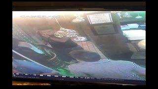 2 thieves steal woman's purse from back of chair at Flanagan's restaurant