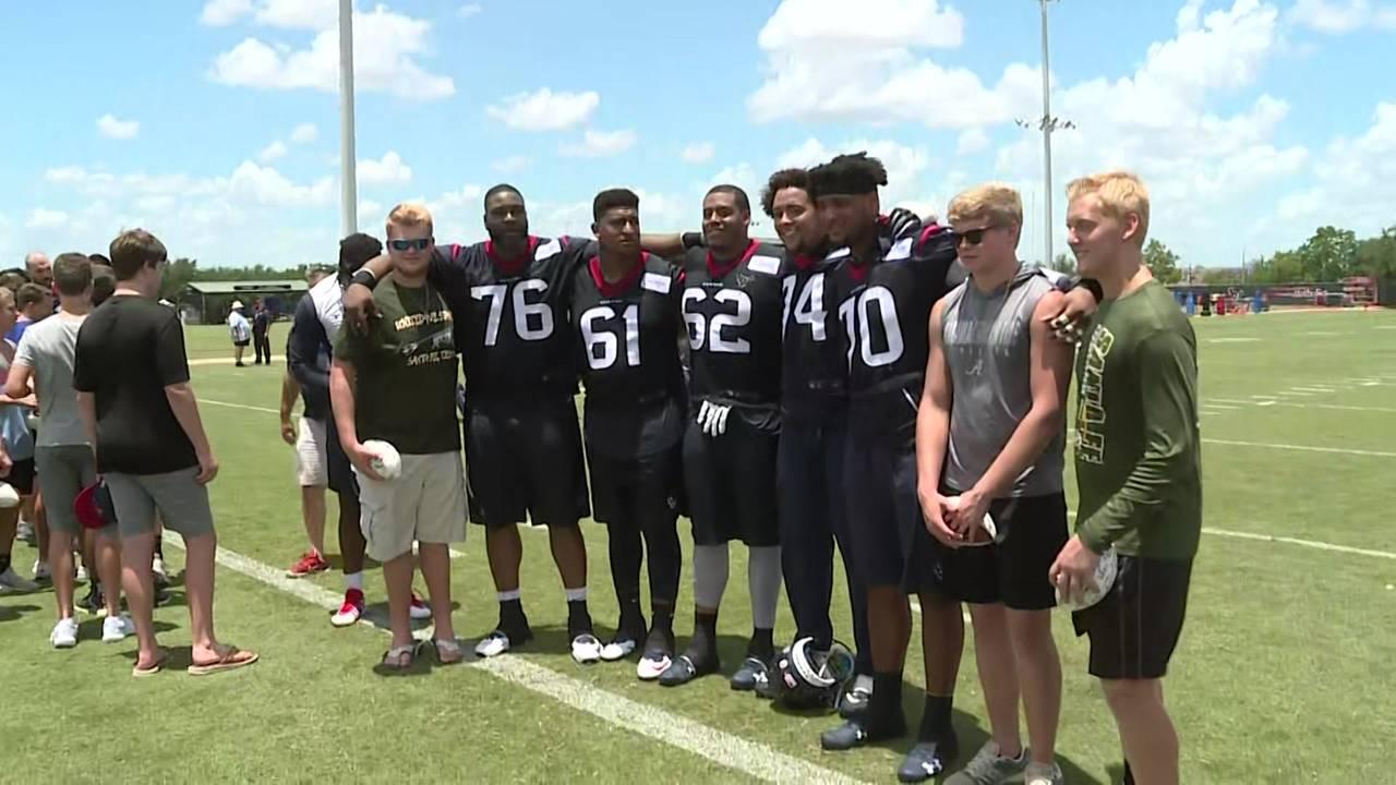 santa fe high school football team visits texans during OTAs