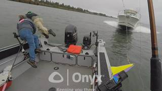 VIDEO: Fishermen leap overboard before being hit by oncoming boat