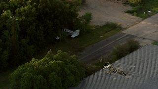 Small plane crashes in woods after hitting roof of La Porte building