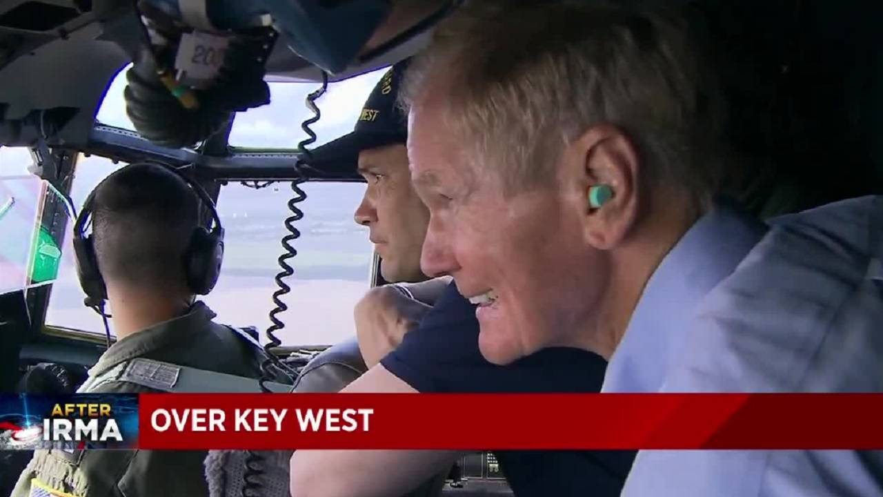 Bill Nelson and Marco Rubio in plane looking at damage