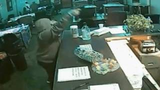 Security guard opens fire on armed robber at internet cafe, deputies say