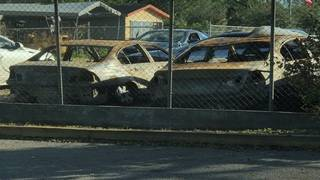Vagrants set fire to cars in dealership lot, manager says