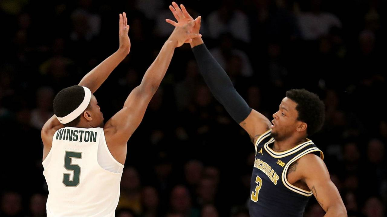 4f77bd333 ... of the Michigan State Spartans takes a shot against Zavier Simpson of  the Michigan Wolverines during the semifinals of the Big Ten Basketball  Tournament ...