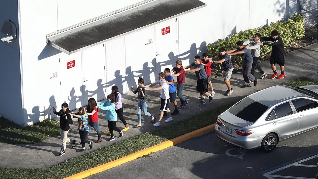 students leave Marjory Stoneman Douglas High School after shooting79229155-75042528
