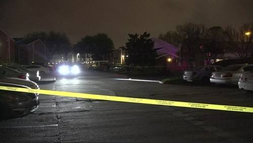 Police investigating after man found shot in apartment parking lot