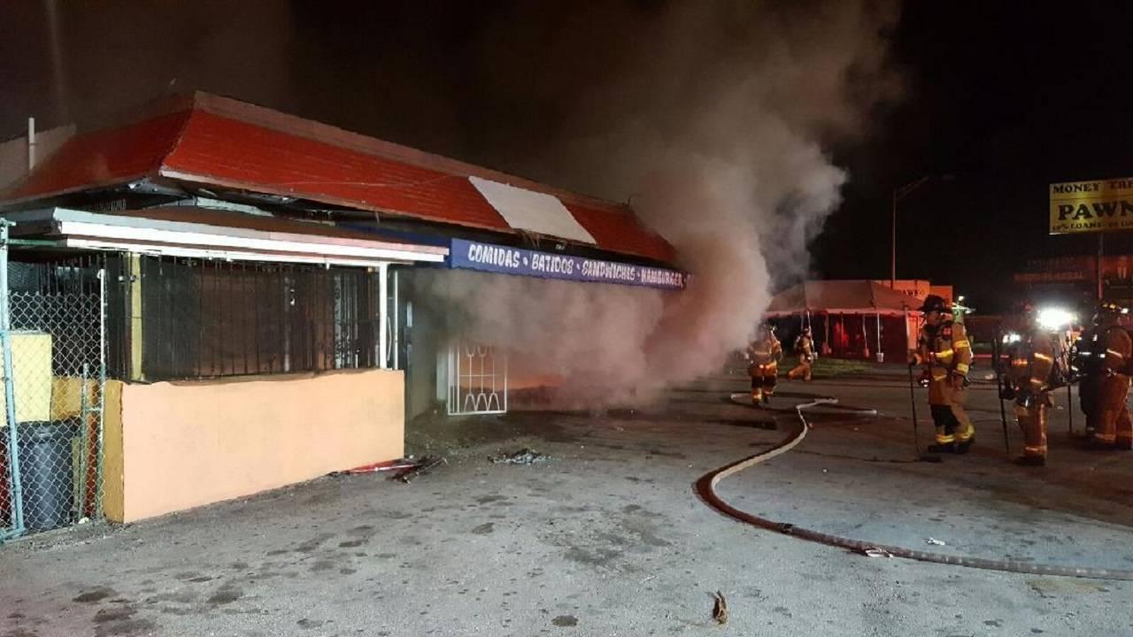 Firefighters battling La Romana Cafe fire