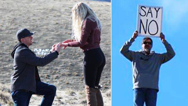 Dad Holds Up Sign That Reads Say No During Daughters Proposal