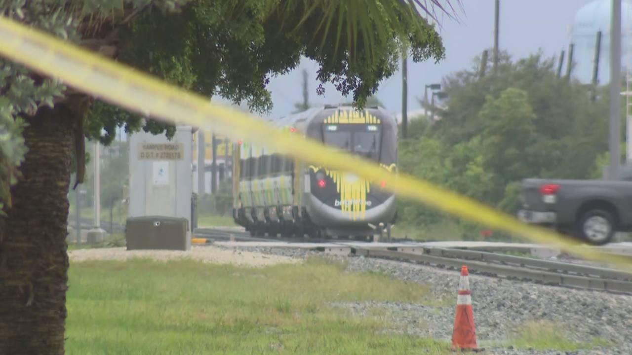 Crime scene tape and Brightline train in Pompano Beach