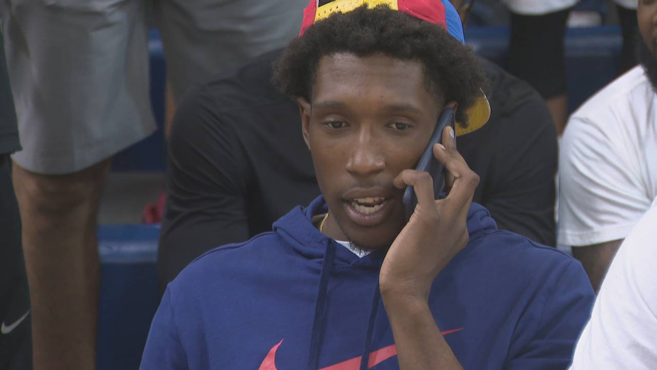 Josh Richardson talking on cellphone at Miami Pro League game