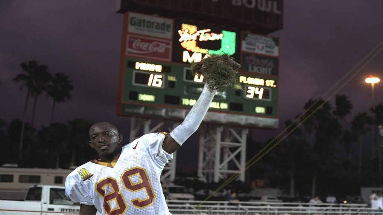 Wayne Messam, Florida State Seminoles wide receiver holds grass from Orange Bowl in 1996