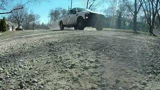 Dirt road riddled with potholes on border of Detroit and Redford Township