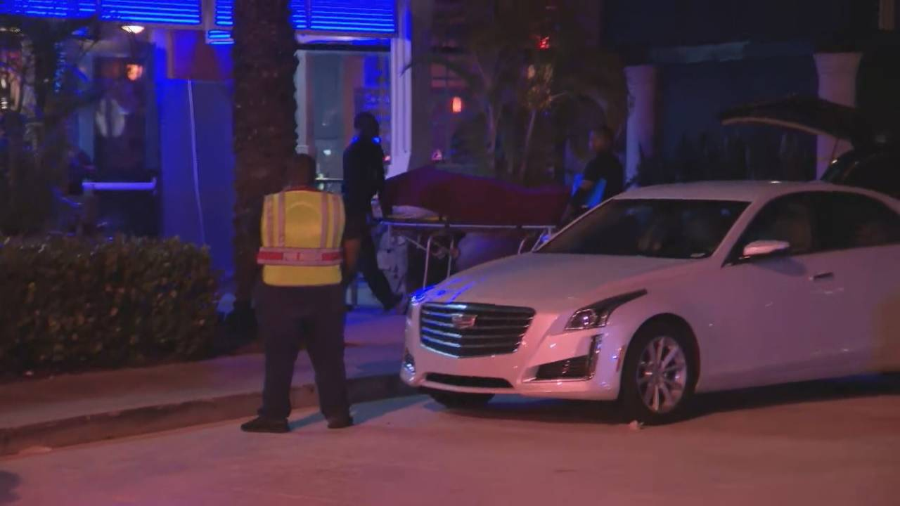 Body removed from Blue Martini after shooting