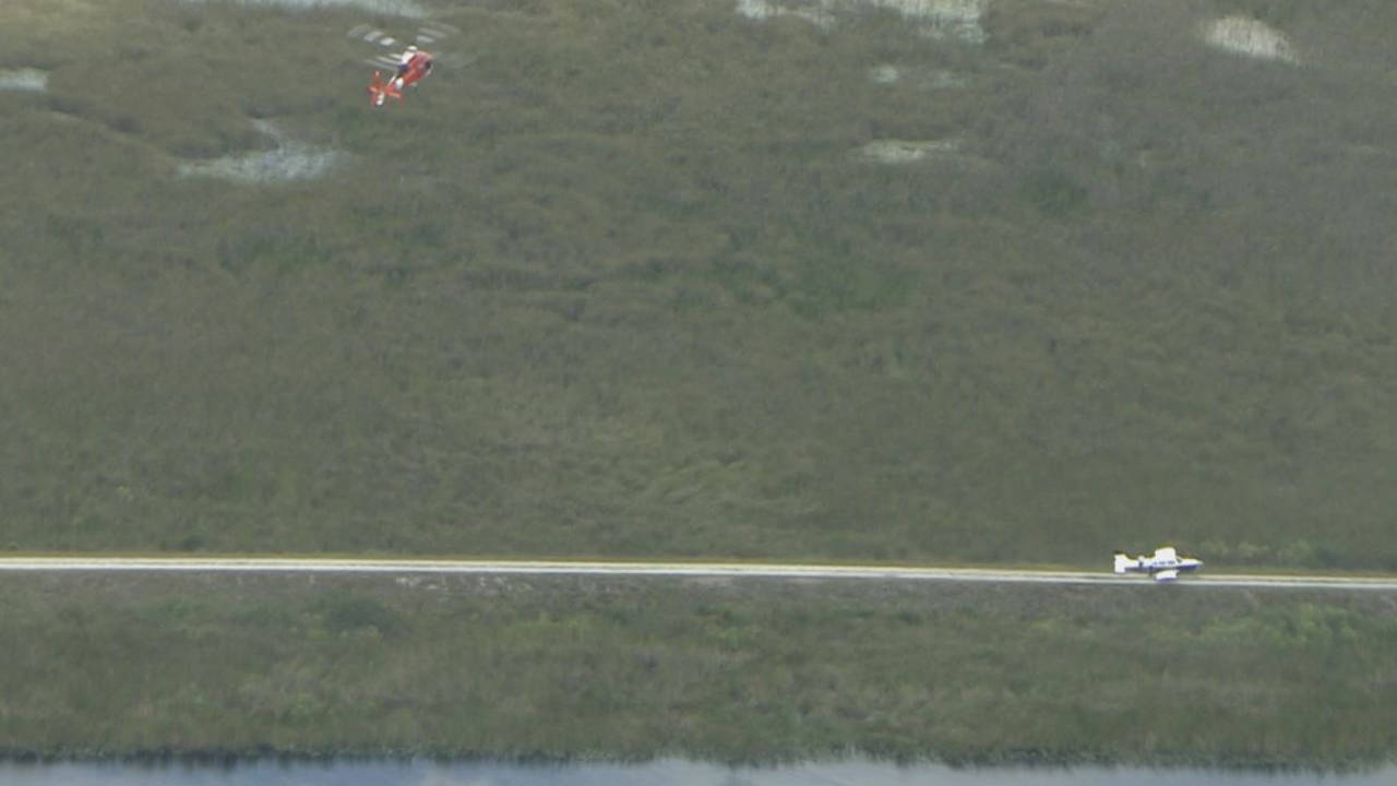 Coast Guard helicopter and small plane