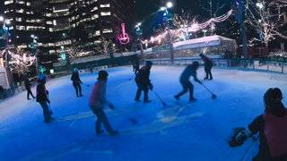 Broomball players invade Detroit's Campus Martius ice rink