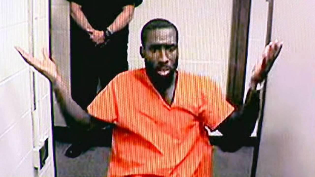 Nathaniel Abraham arraignment arms thrown up