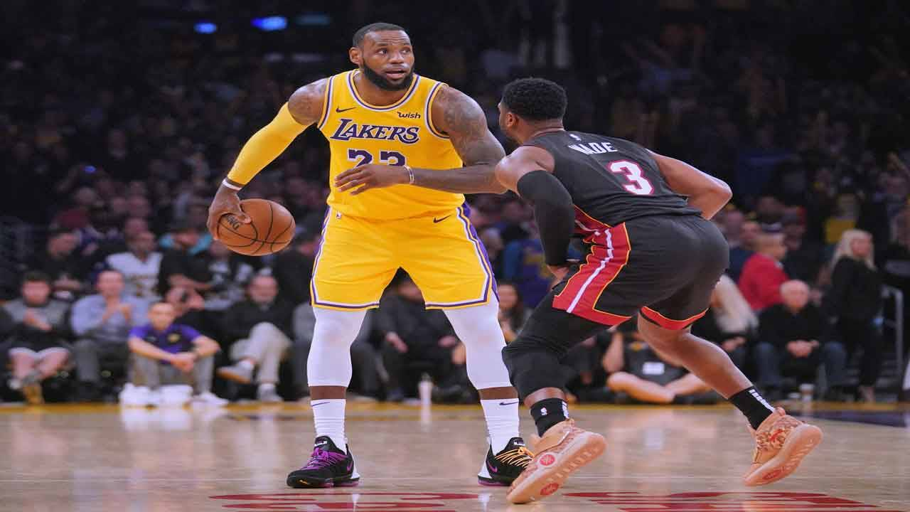 Los Angeles Lakers star LeBron James guarded by Miami Heat star Dwyane Wade