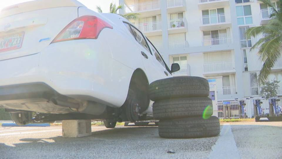 Tires being replaced on car in Miami Beach
