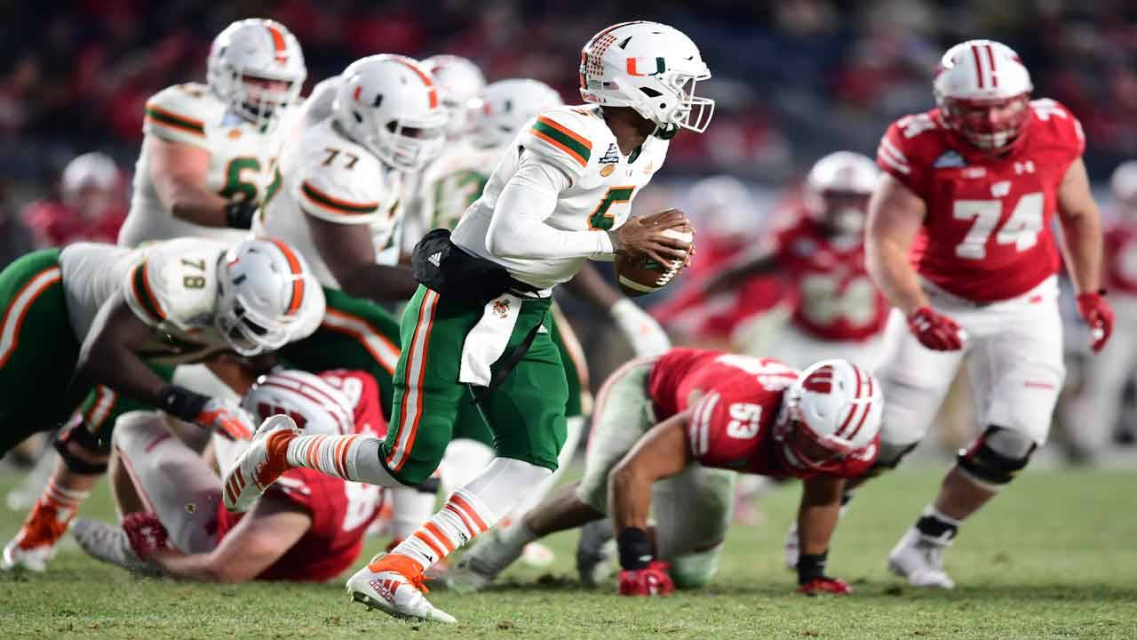 Miami Hurricanes QB N'Kosi Perry runs with ball against Wisconsin Badgers in 2018 Pinstripe Bowl