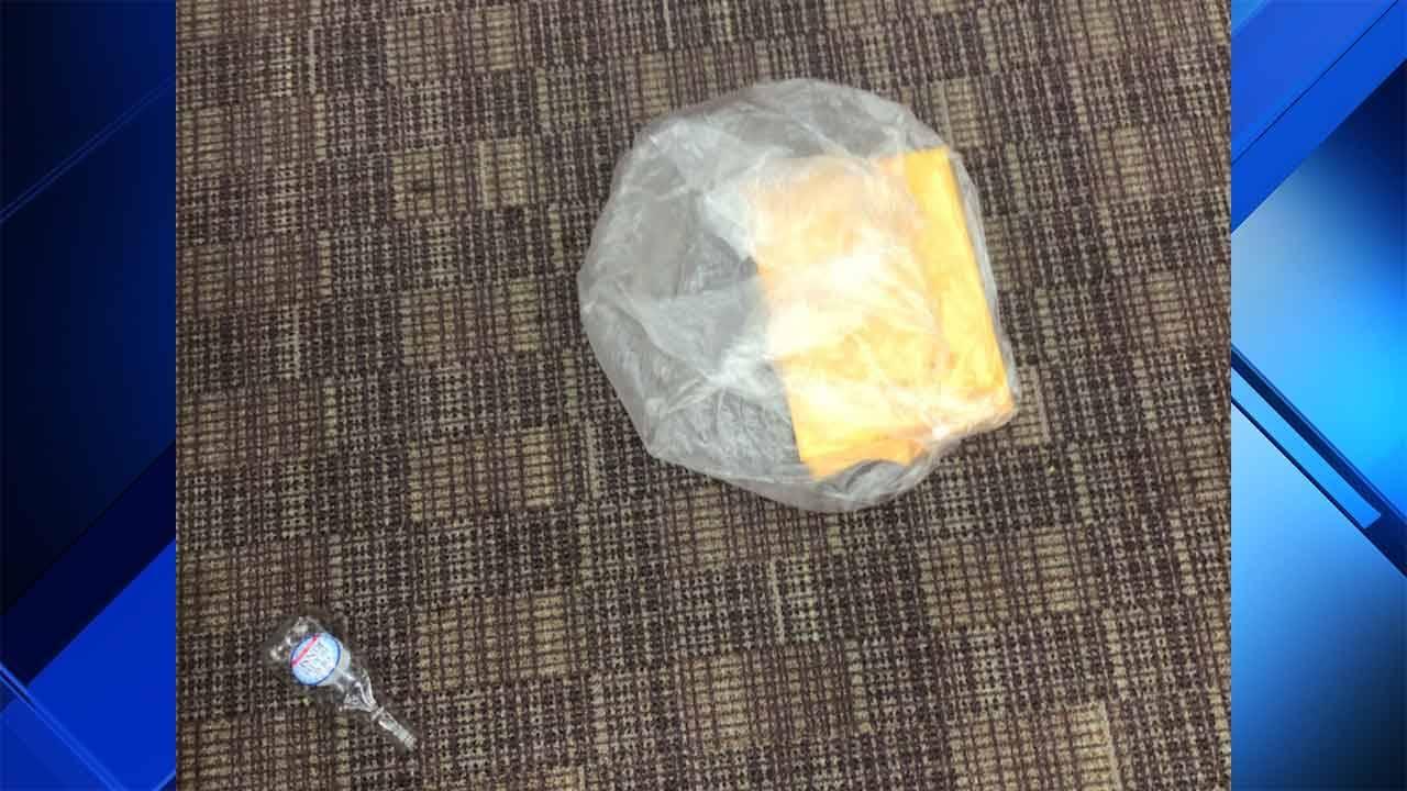 Hand sanitizer bottle possibly used to hide urine on floor of courtroom