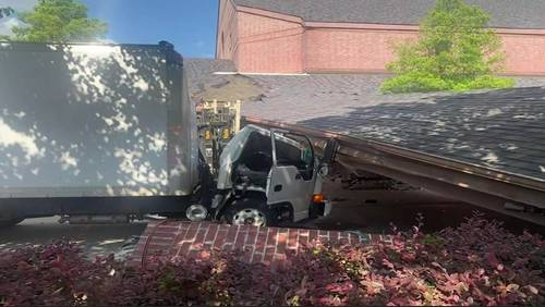 Part of church collapses on box truck, trapping driver