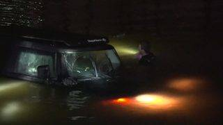 SUV ends up in pond near Williams Tower