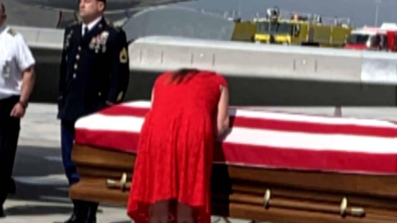 Jonathan Farmer's wife kisses casket