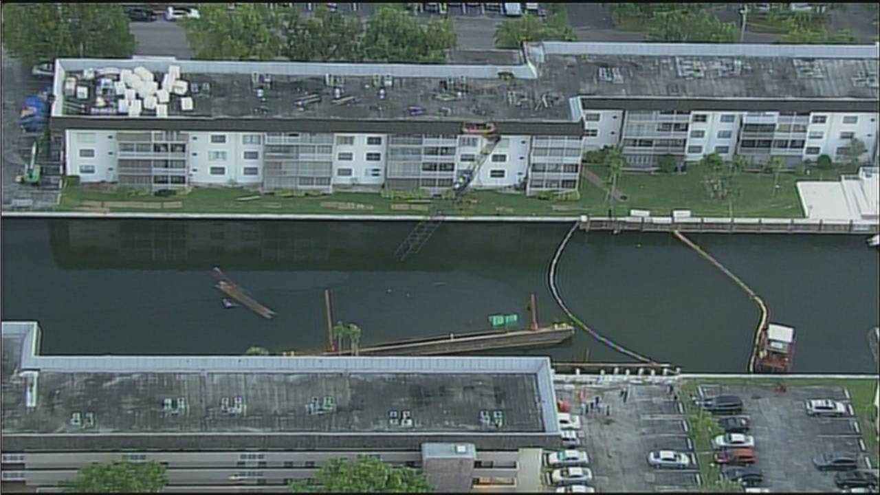Wide Sky 10 view of crane collapse onto building in North Miami Beach