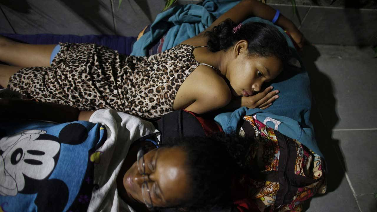 Venezuelan migrants sleeping on the floor