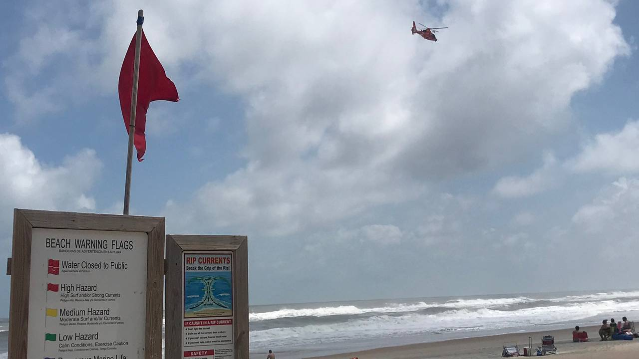 Red-flag-and-helicopter_1568667397066.jpg