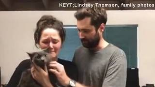 Woman sobs after reuniting with cat lost in Calif. mudslides