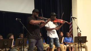 Members of 'Black Violin' perform for children in South Florida