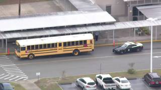 Driver hits bus at Narcoossee Middle School, troopers say