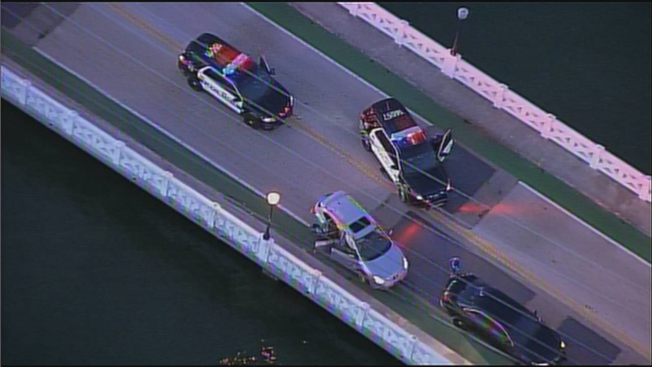 Sky 10 stolen car on Venetian Causeway surrounded by police cars