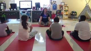 Elementary school students use yoga to manage classroom stress