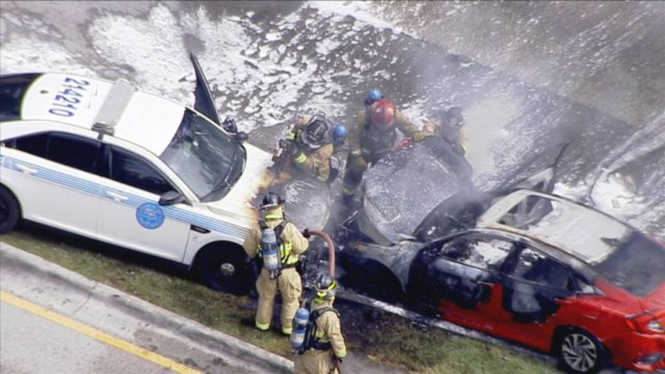 Firefighters extinguish flames to burning car after chase in Miami
