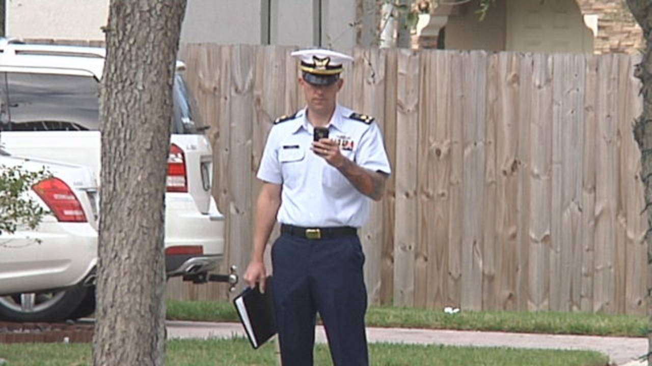 Coast Guard service member outside murder suicide home