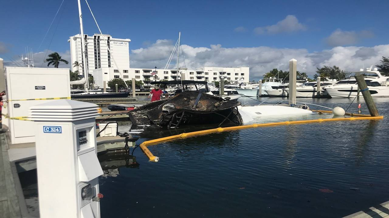 Scorched boat pulled from water off Bahia Mar marina