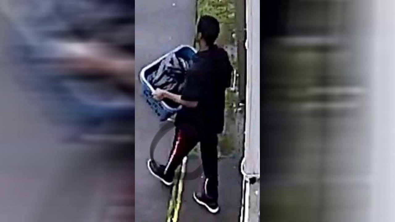 surveillance photo of Darion Vence leaving apartment