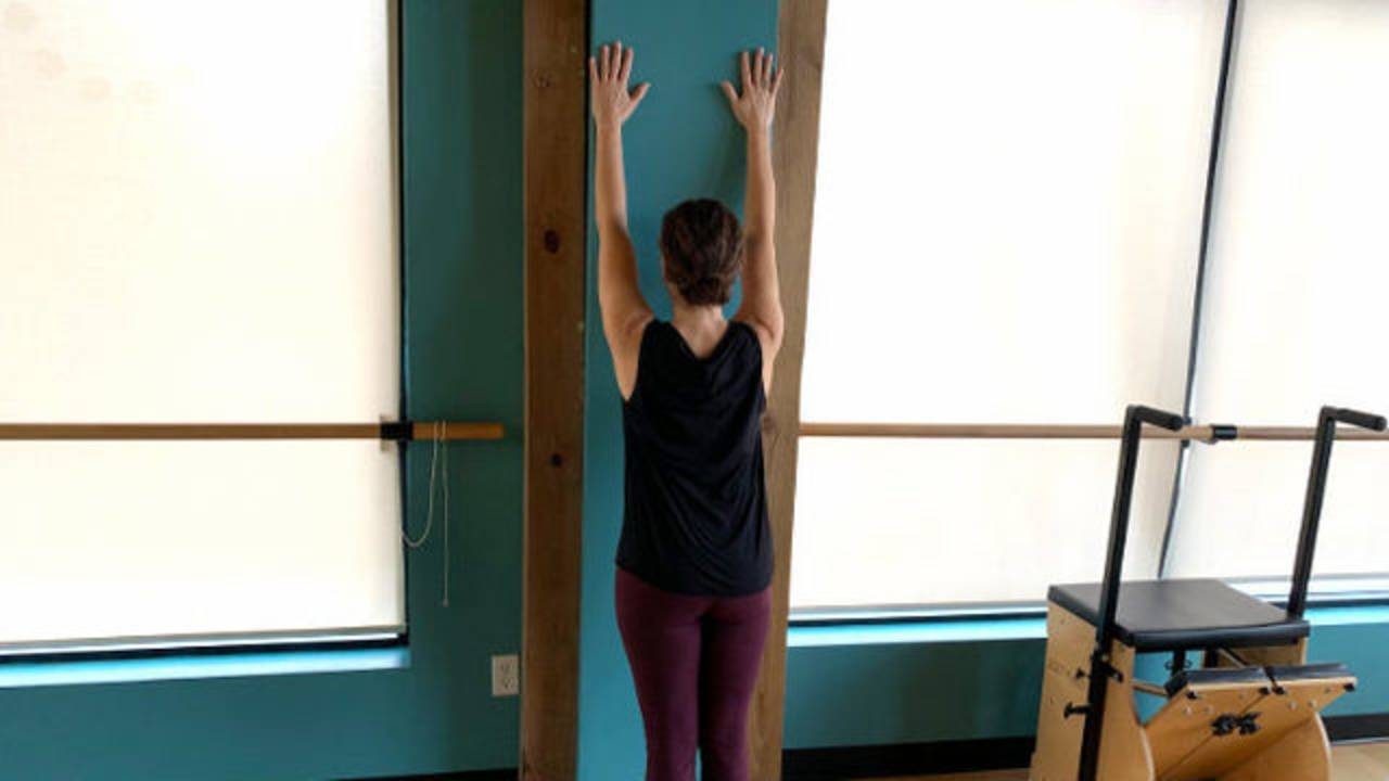 Standing wall stretch 1