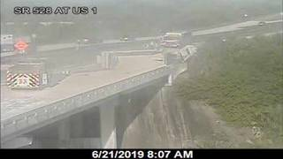 Overturned tractor-trailer carrying rocks closes SR 528 in Cocoa