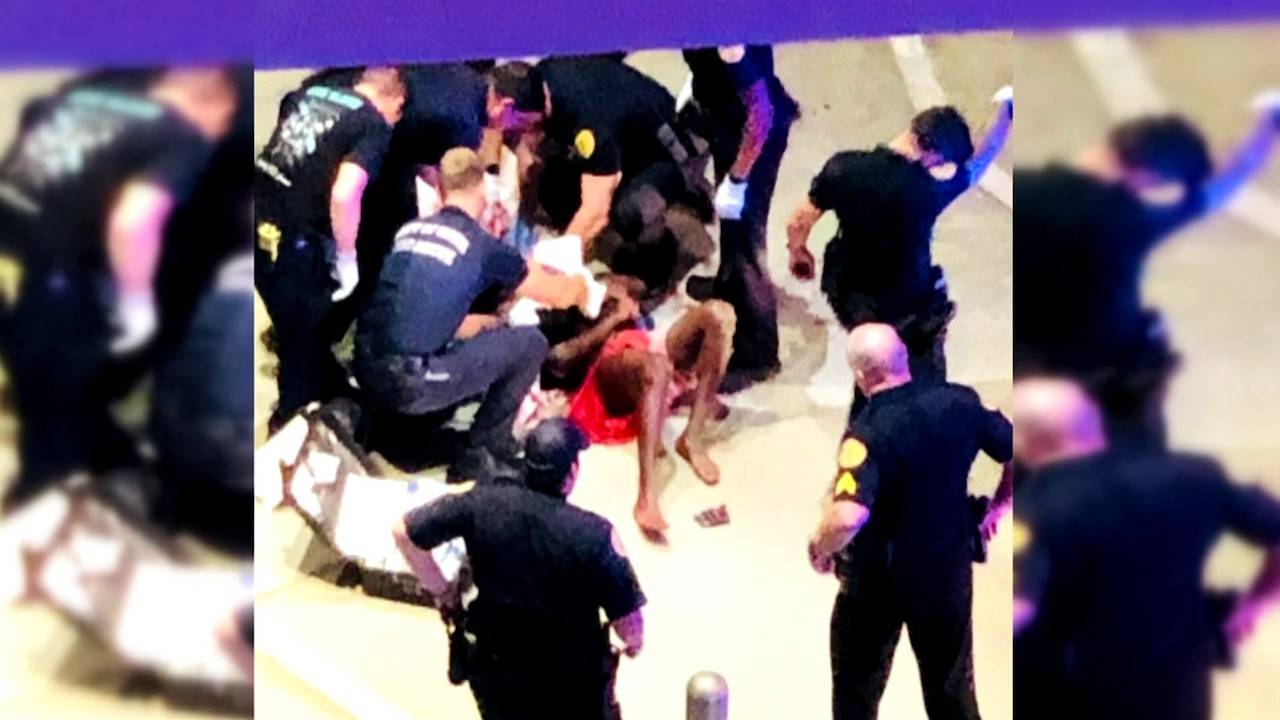 Man being treated by paramedics after being stabbed_1561067885111.jpg.jpg