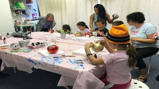 Children make ornaments for families affected by Hurricane Michael